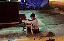 菲律宾麦当劳新年季宣传活动  爱学习的小男孩